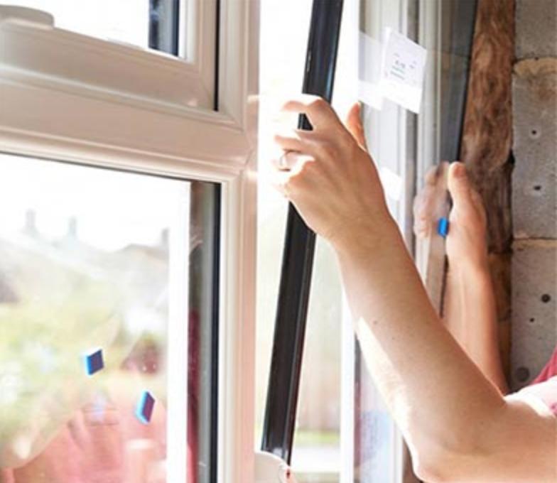 Pose de verre sur fenêtres